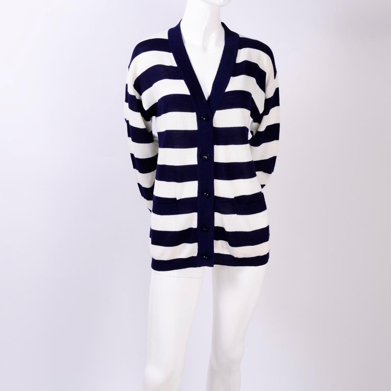 This is a great navy blue and white striped cardigan by Yves Saint Laurent. This soft wool/acrylic/cotton blend sweater has a  V neck and was originally purchased at I Magnin in the early 1980's. The sweater buttons up the front and has two pockets