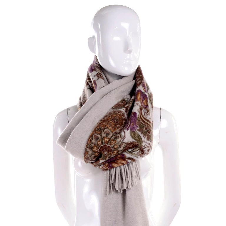 This is a luxurious Loro Piana cashmere scarf or wrap in a beautiful rich print in shades of purple, green, burgundy and beige on a beige background.  The scarf can be worn with the solid side or printed side up.  New with original tags attached,