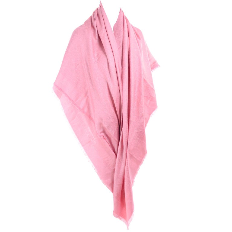This pink jacquard Fendi scarf would also make a perfect shawl and it was never used! This is a lovely Fendi wrap or scarf that measures 56