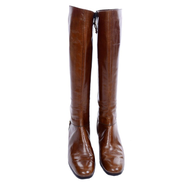 These are Salvatore Ferragamo designer caramel leather boots from the 1970's that have barely worn. They are almost like riding boots with a heel but there is a side zipper for ease in taking on and off, and a Ferragamo metal logo. These boots have