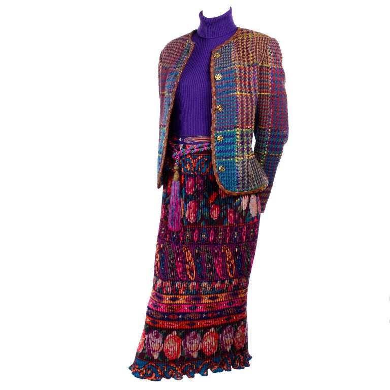 This is a beautiful Emanuel Ungaro outfit with so many wonderful textures, colors and patterns!  This incredible ensemble includes a pleated floral patterned skirt, a purple knit turtleneck, a multi colored tweed jacket, and a colorful rope belt.