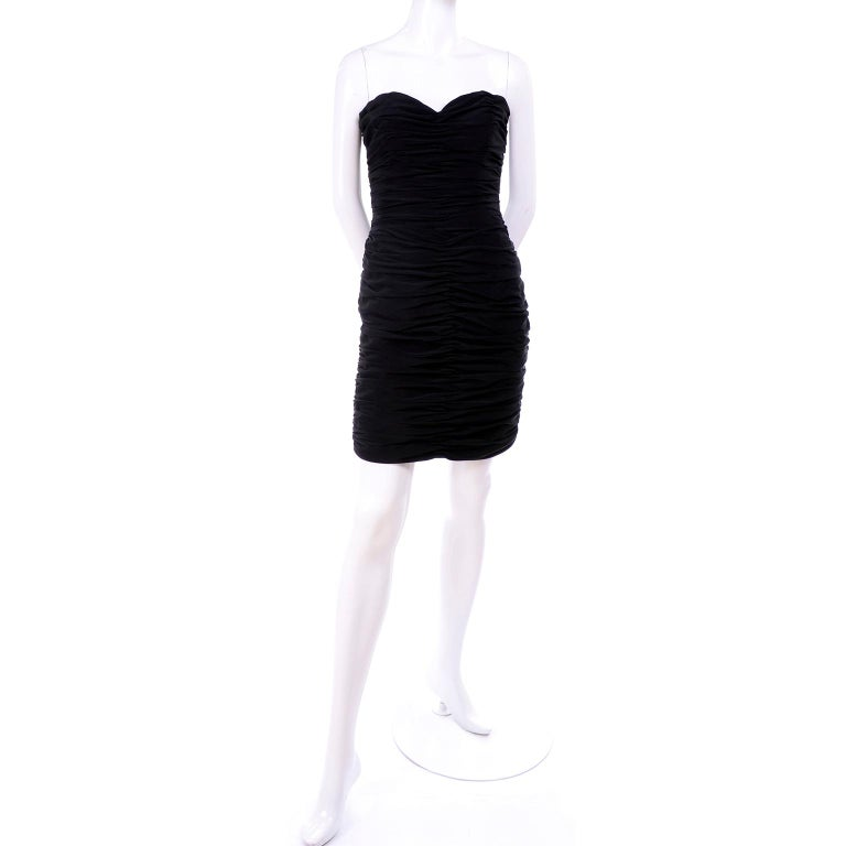 This is a gorgeous 1980's Azzaro Boutique bodycon vintage dress in ruched fine black crepe. The strapless little black dress has a back zipper and boning in the bodice. Fits our size 2 mannequin perfectly! The dress has a label that reads: Betsy and
