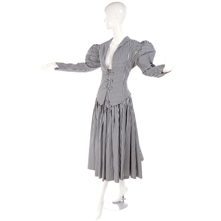 We are obsessed with vintage Norma Kamali and we adore this ensemble! This 2 piece outfit includes a super high waisted skirt that comes to the underside of the bust and a jacket that loosely closes with covered buttons.  We love the Victorian