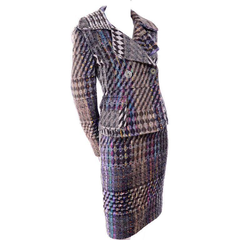 We love Christian Lacroix vintage clothing and this suit is a perfect example of his timeless talent.  The rich, colorful plaid wool/cotton/nylon blend fabric has woven threads in shades of yellow, blue, purple, green and pink,  The outfit can be