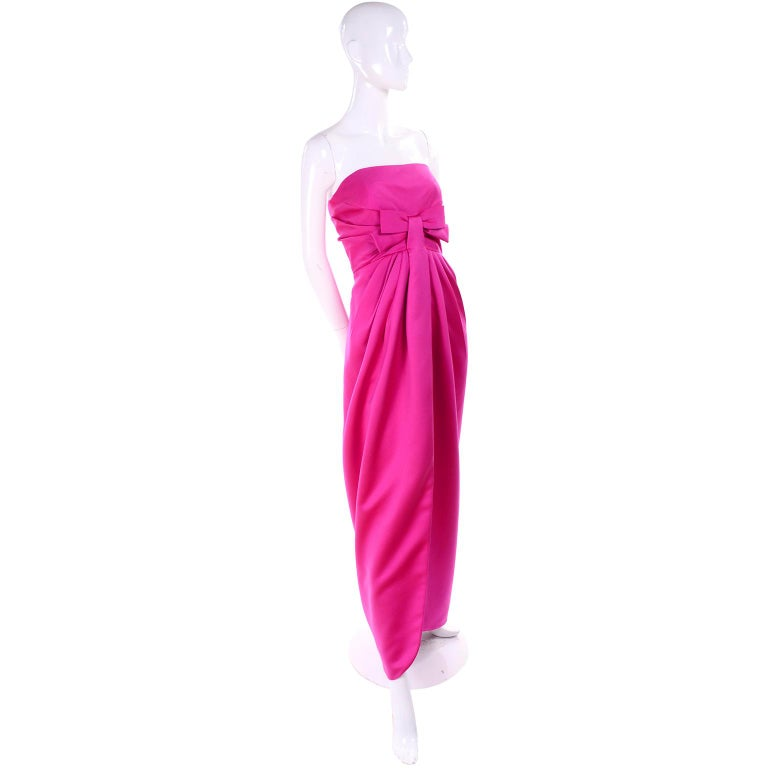This wonderful vintage pink satin dress was designed by Victor Costa in the late 1980's. This evening gown is in such a wonderful shade of pink and it comes with a long sleeve cropped bolero jacket for those chilly evenings.  The dress is strapless