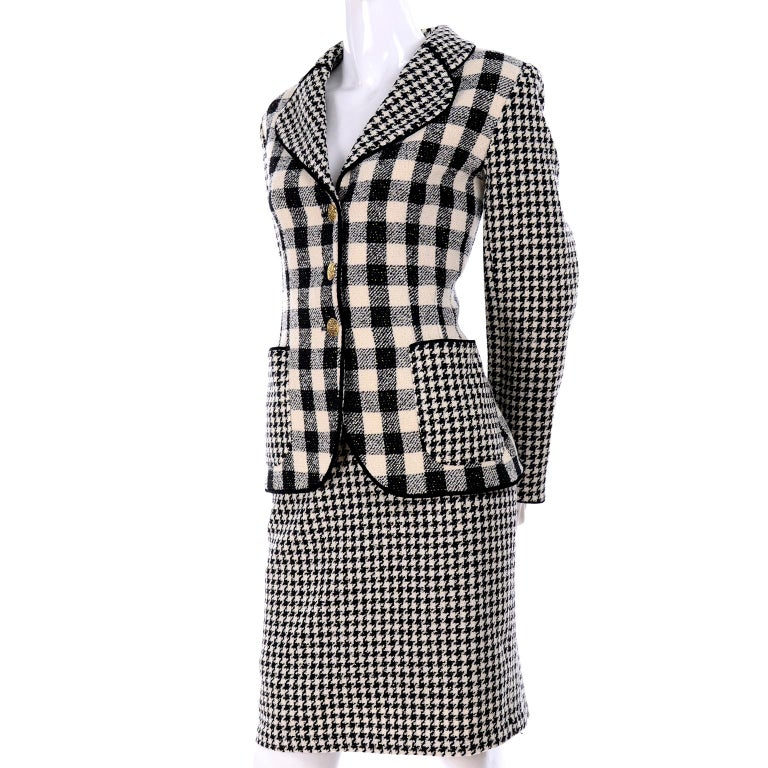 This wonderful 1990's skirt suit was designed by Emanuel Ungaro and offers two great separates that can be worn with so many other pieces! This Ungaro Parallele outfit includes a jacket in a houndstooth black and white wool check with a contrasting