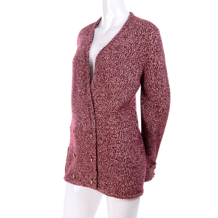 This is a luxurious cashmere vintage cardigan Chanel  sweater with front pockets and upturned cuffs with 2 Chanel interlocking C buttons on each.  We purchased this from an estate that had an exceptional wardrobe of designer clothing and
