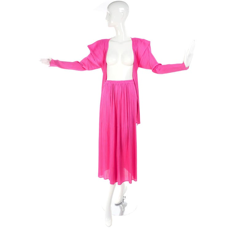 This is a great hot pink pleated Issey Miyake Skirt and top or Cardigan ensemble. This outfit came from an estate we acquired of exceptional avant garde designer clothing and accessories.  The open front cardigan top has asymmetrical structured