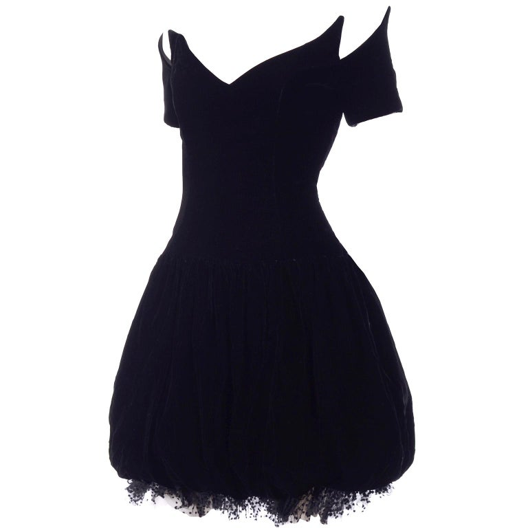 This is an absolutely stunning vintage black velvet Christian Dior party dress! This Dior beauty has a pouf skirt and a 2