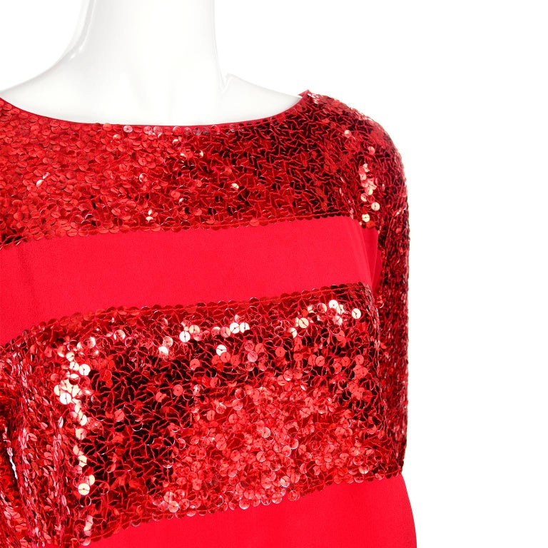 This beautiful vintage Nina Ricci top came from an unbelievable estate of only the very best designer clothing. We acquired this estate recently and were so impressed with this woman's taste and sense of style. This top is red silk with rows of