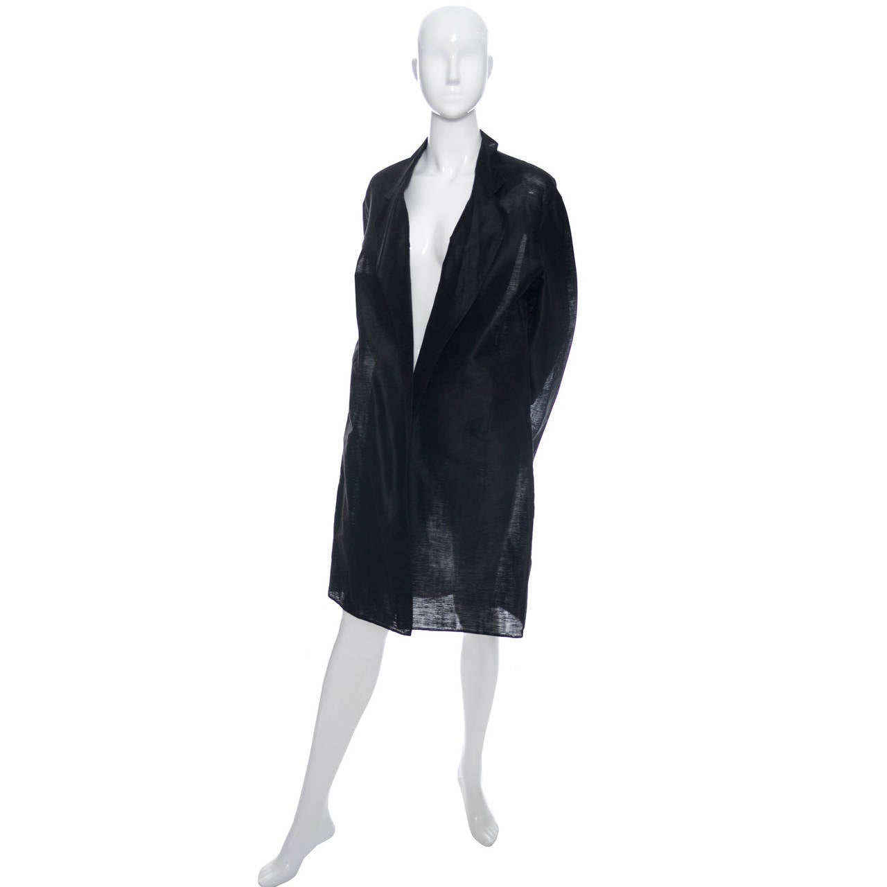 Gorgeous vintage Donna Karan black semi sheer linen organza evening coat with open front. This is such a great essential basic jacket to have to throw over a cocktail dress or wear with a pair of silk pants. It was hard to photograph this coat and