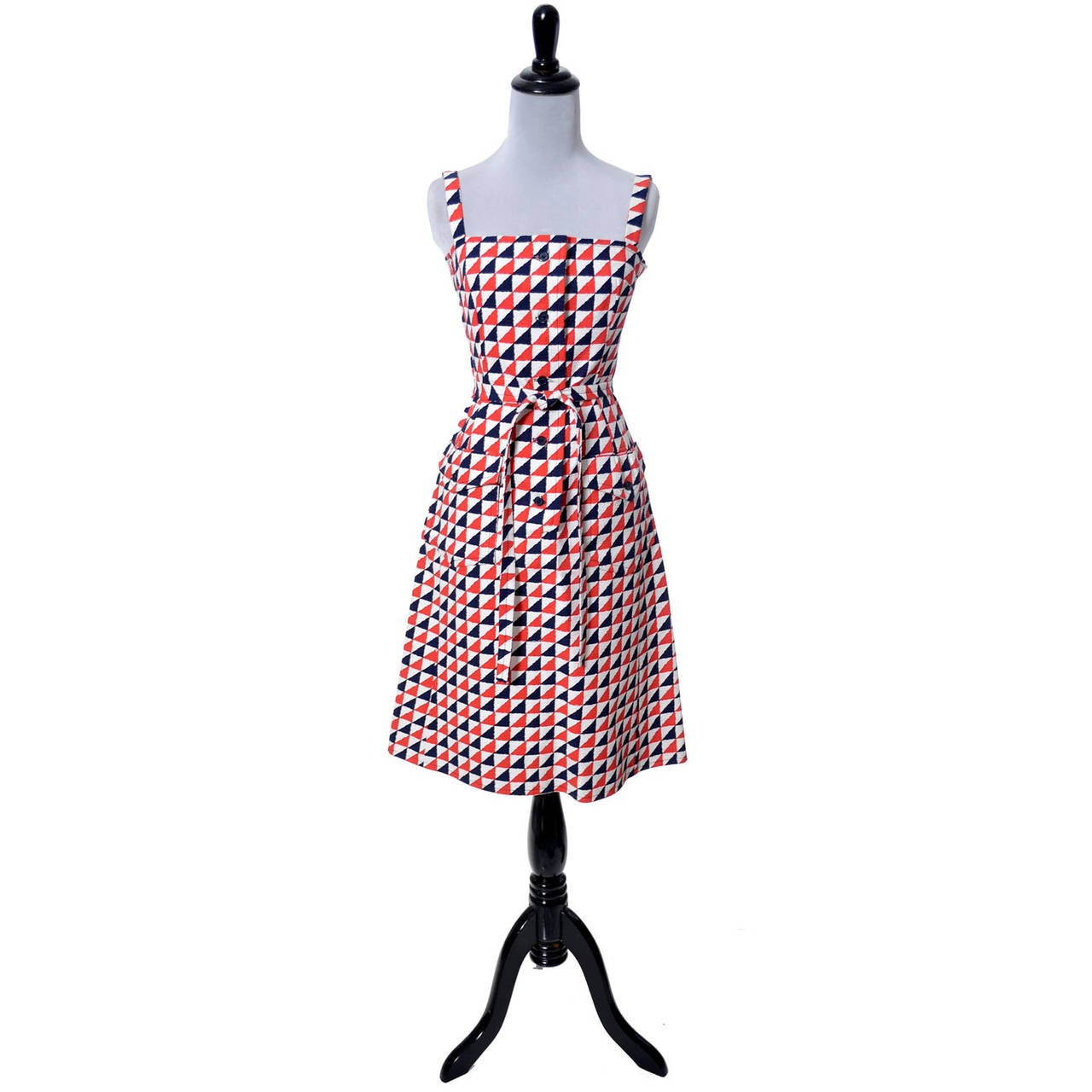 This is a wonderful Givenchy Nouvelle Boutique vintage dress from the 1970s in a red white and dark blue crisp structured cotton print.  This vintage dress appears to have never been worn and has front pockets and its original fabric belt.  I've