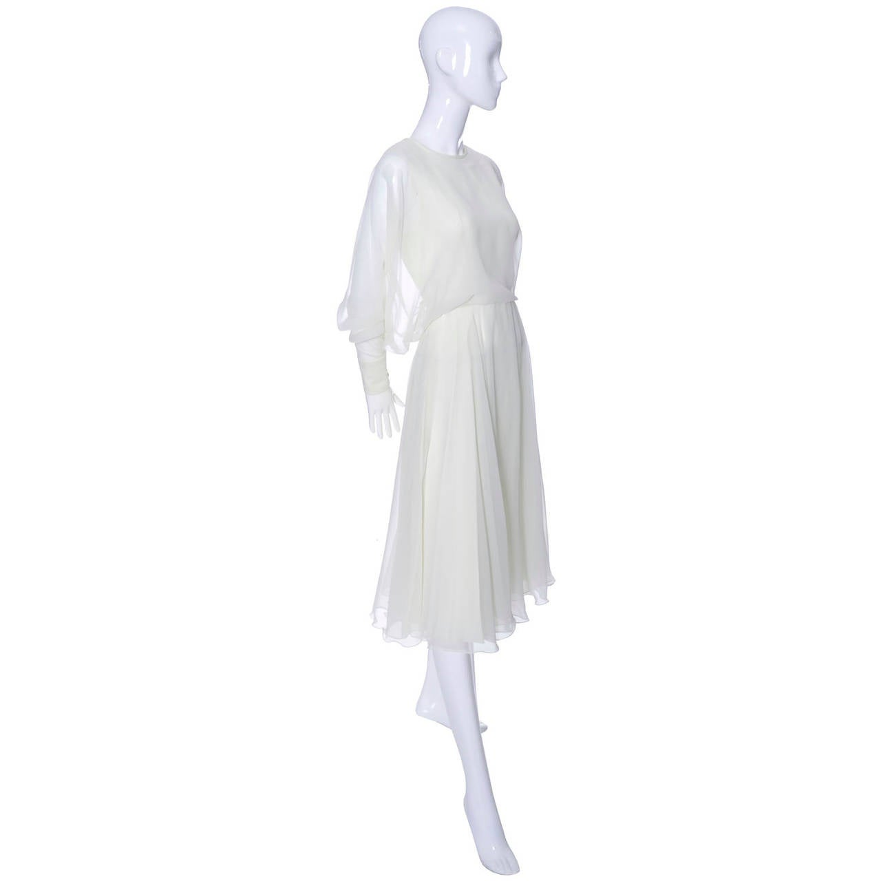 This is a 1970's dreamy ivory chiffon vintage dress with the Jean Varon label. Jean Varon was a label that was designed by John Bates, who supposedly chose the name because he thought a french name would be more successful in the fashion industry