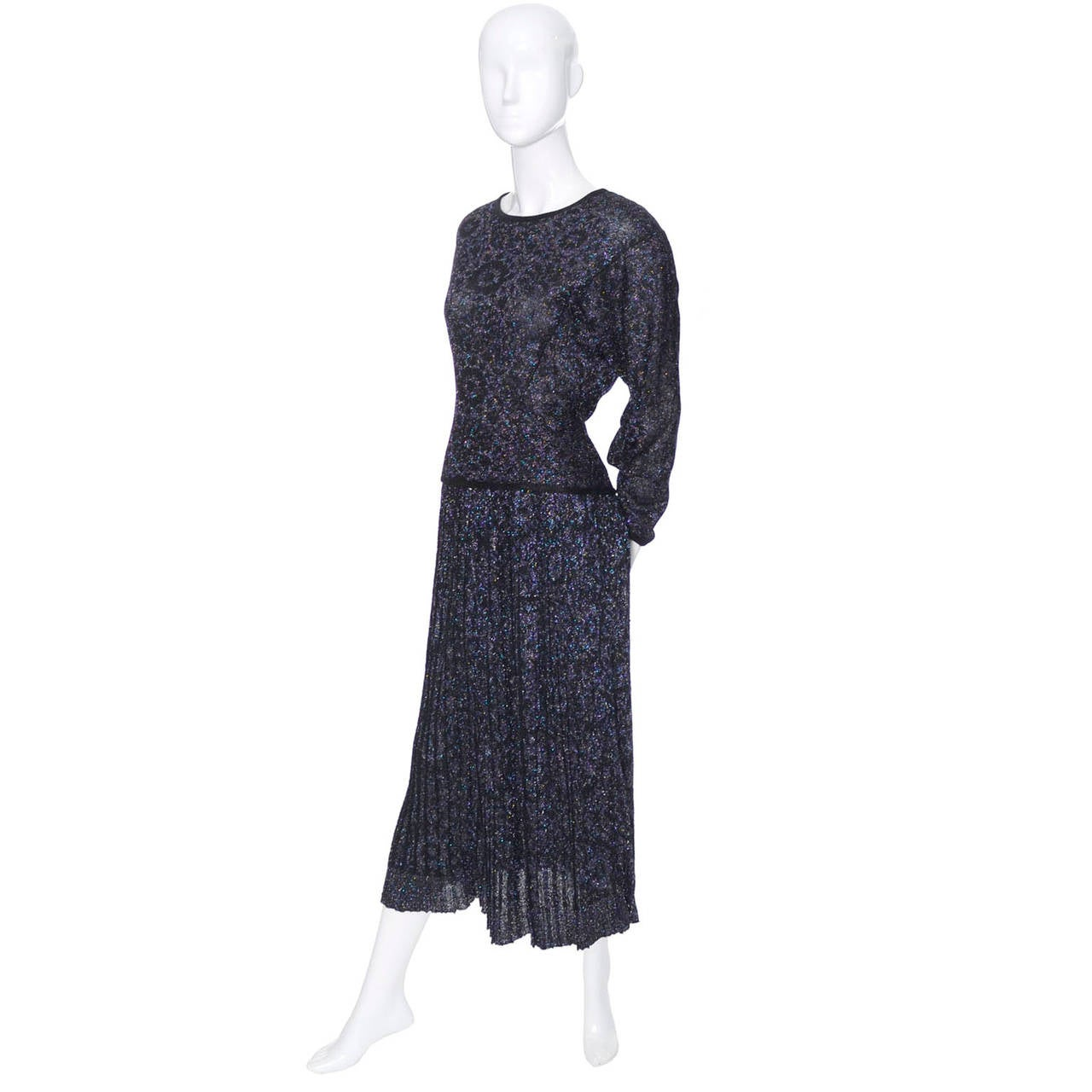 This is a 2 piece vintage Missoni iridescent sparkle outfit with pleated skirt and long sleeved top.  This ensemble was purchased at Saks Fifth Avenue in the 1980's and is labeled an Italian size 44. You can make out a pretty floral pattern in the