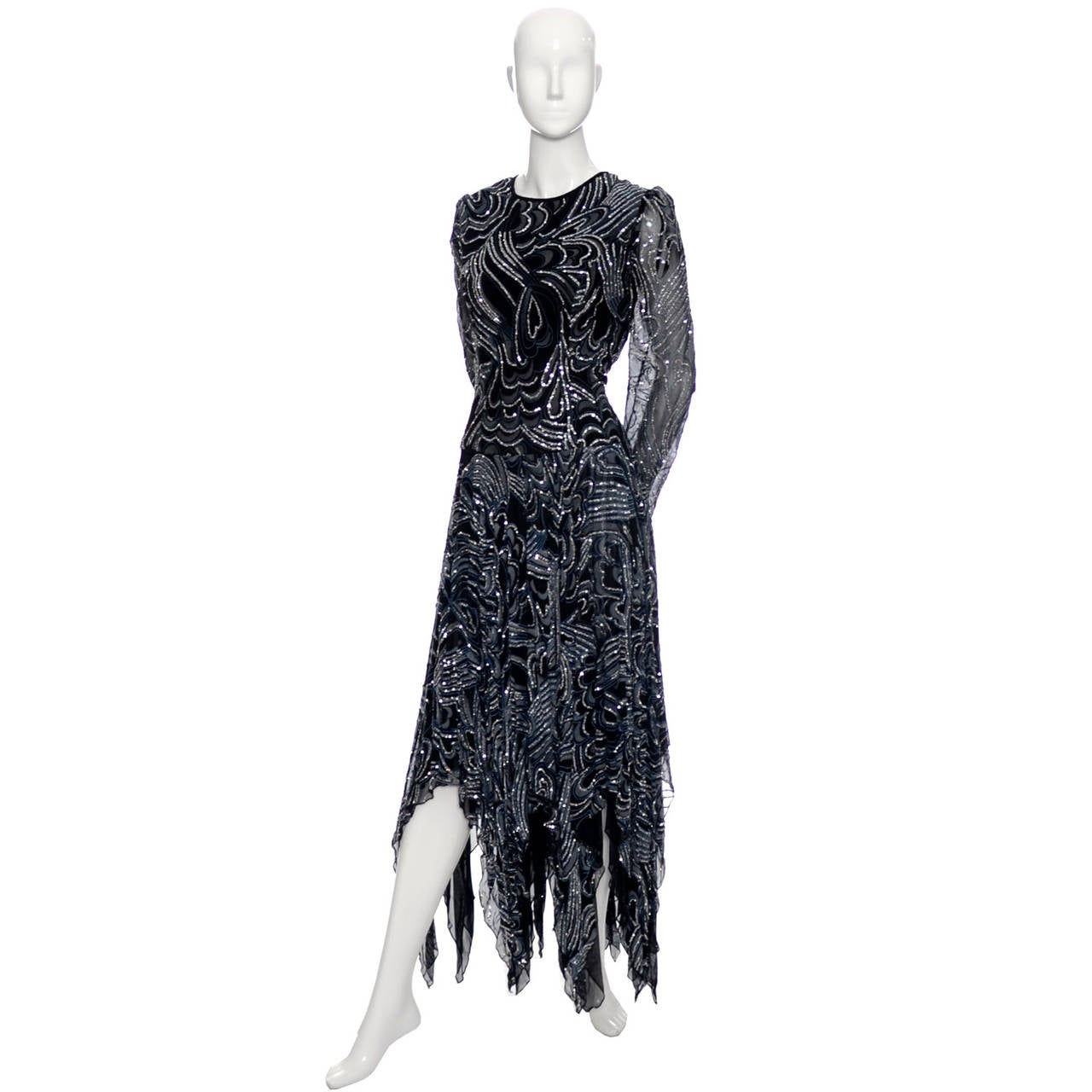 This 1980's vintage dress is from the British designer, Terence Nolder, who worked for Alfred Radley at Quorum and won the British Evening wear Designer Award in 1980 and The British Designer of the Year Award in 1981. This dress is in excellent
