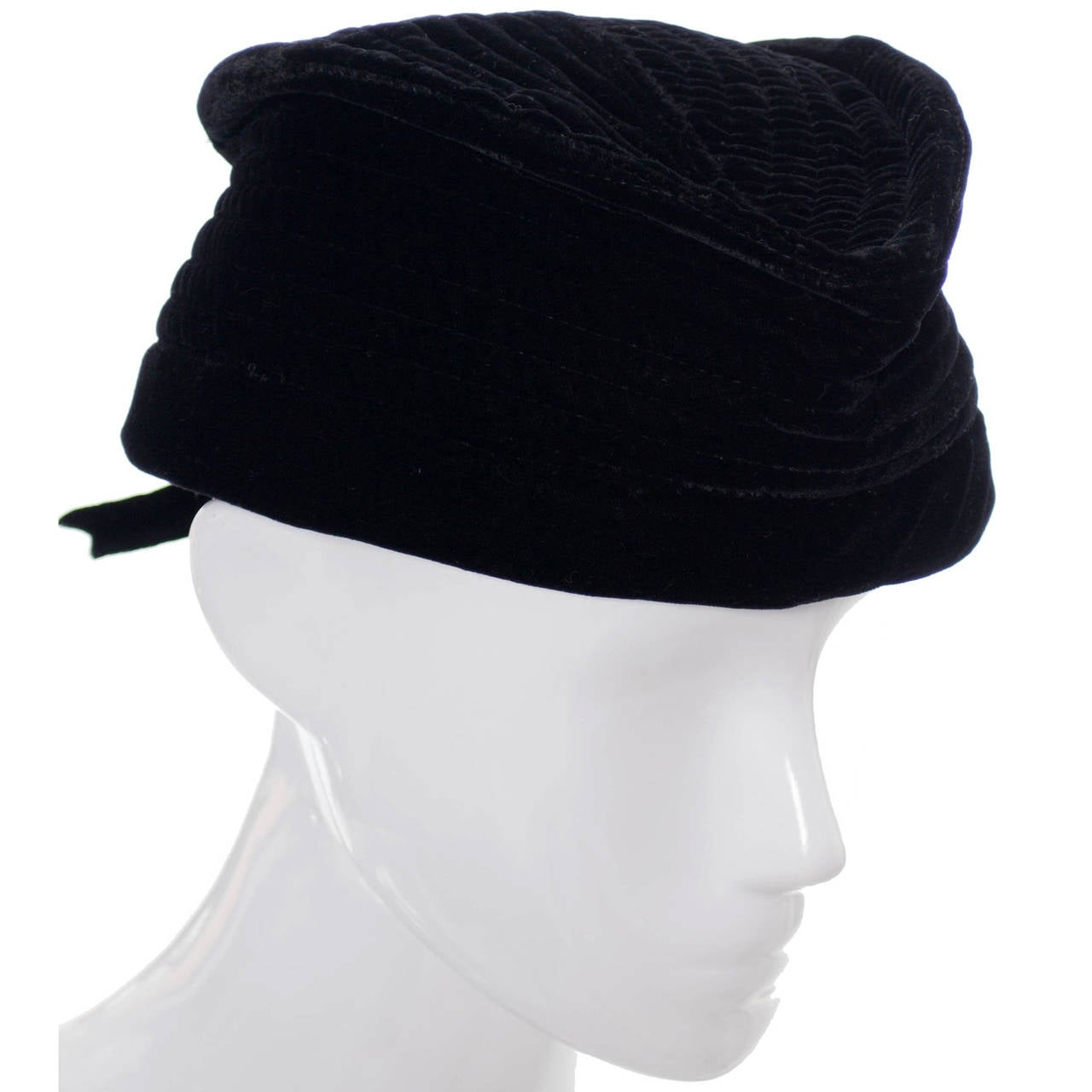 This exceptional vintage Valentino Garavani Boutique hat is in pristine condition and has beautiful rows of top stitching and a pretty bow in the back. The hat is made of black velvet and is marked as a European size 56, which converts to a US size