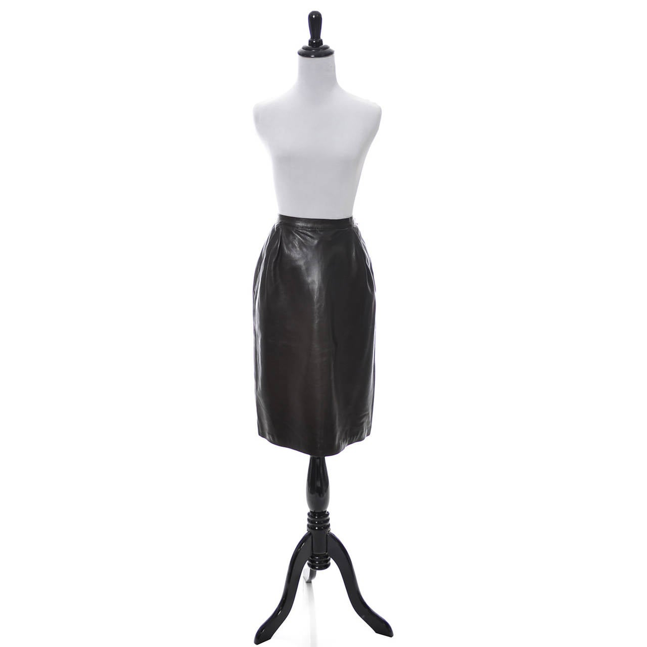 Yves Saint Laurent Rive Gauche vintage leather skirt from the 1970s.  This gorgeous vintage dark chocolate brown 1970s YSL leather skirt comes from one of my all time favorite estates of vintage clothing. The woman who owned this barely, if ever
