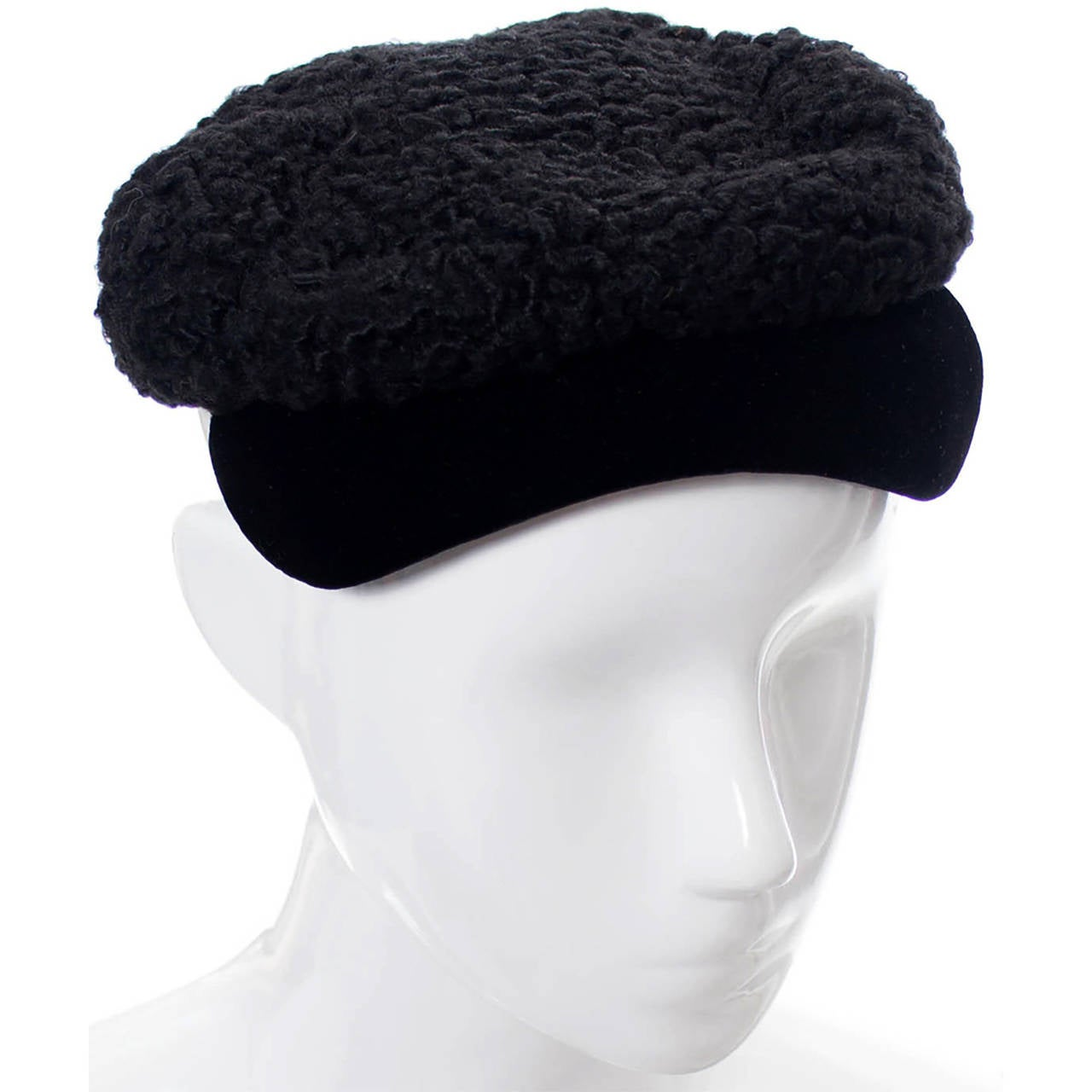 If you collect vintage hats or specifically love the designer Hattie Carnegie, you will adore this little curly lambswool vintage cap with black velvet brim! From a prominent estate, you'll find it in excellent condition! This vintage hat measures