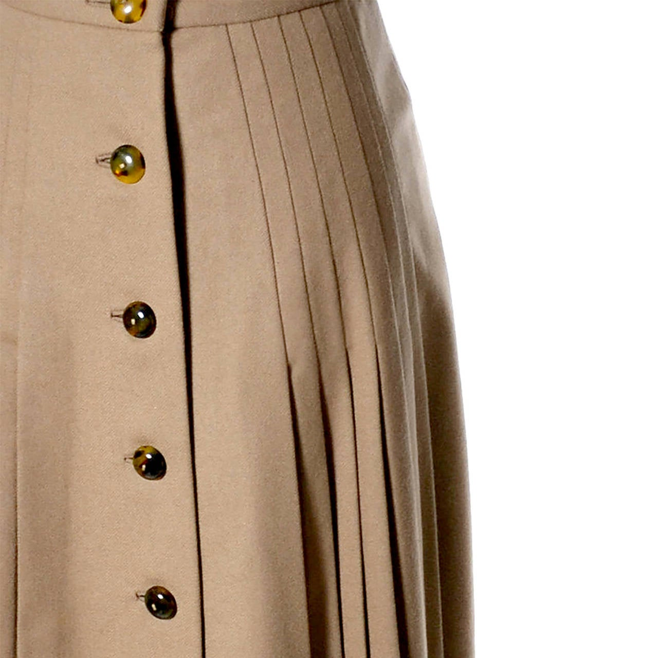 This rare, older label vintage Valentino late 1960's or early 1970's pleated camel wool skirt is in mint condition. The skirt has fabulous buttons and is fully lined.  This vintage Valentino skirt is a collectible piece that comes from an estate of
