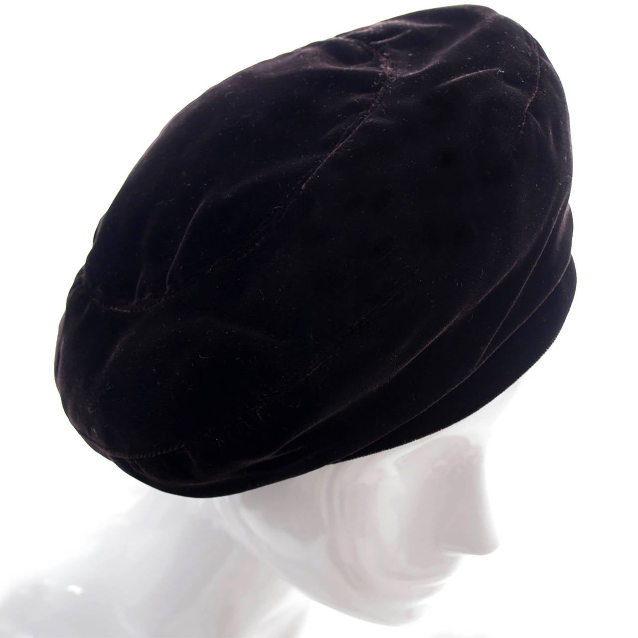 This vintage YSL hat is in a rich, luxurious chocolate brown velvet.  A beautiful 1970's beret from an estate of outstanding vintage clothing and accessories. The hat measures 21 and 1/2 inches in circumference and has the Yves Saint Laurent Rive