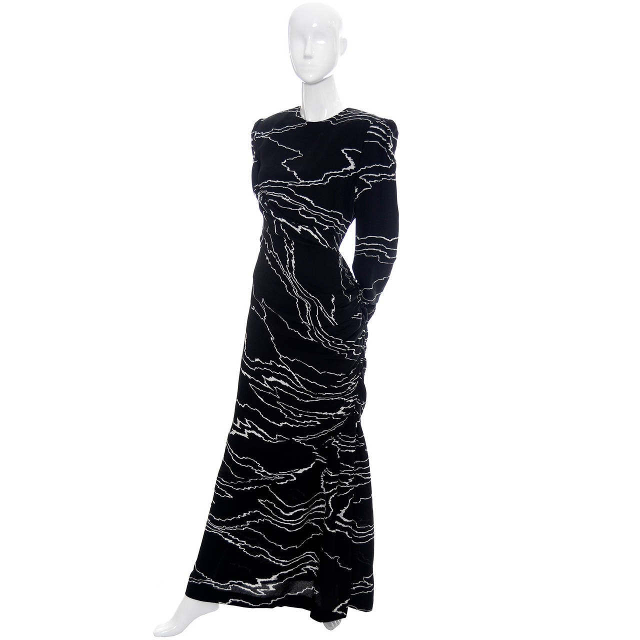 This elegant Bill Blass designer vintage dress is from the 1980s and is in a stunning black and white abstract print. There are two zippers, shoulder pads, and incredible draping.  This is a fabulous dress and the side gathers add just the right