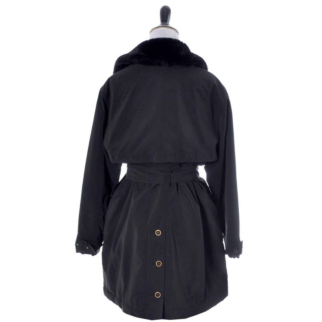 This is a fab vintage soft black Sonia Rykiel designer raincoat with its original belt and a great faux fur collar.  This trench coat style double breasted jacket has black quilted lining, Sonia Rykiel logo buttons and is in excellent condition. I