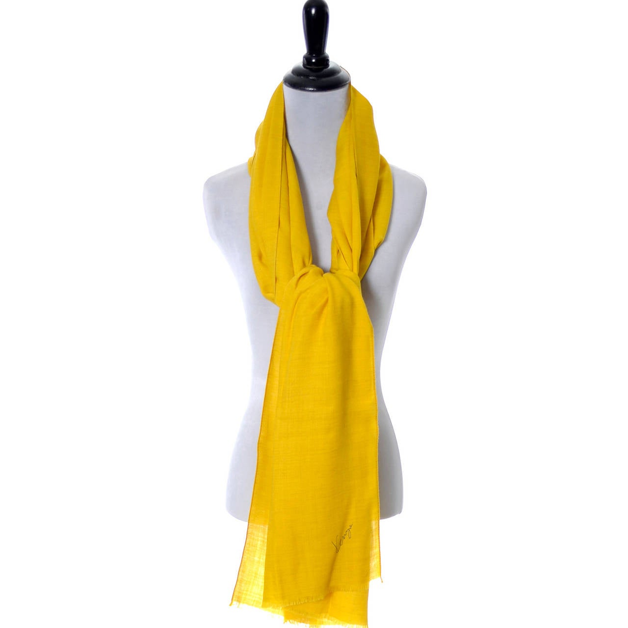 This is a gorgeous mustard yellow vintage scarf from Kenzo Paris with the Kenzo signature logo on the front. This beautiful scarf  is in an ultra fine lightweight wool and can be worn as a shawl - it measures 27 by 80 inches so it's the perfect