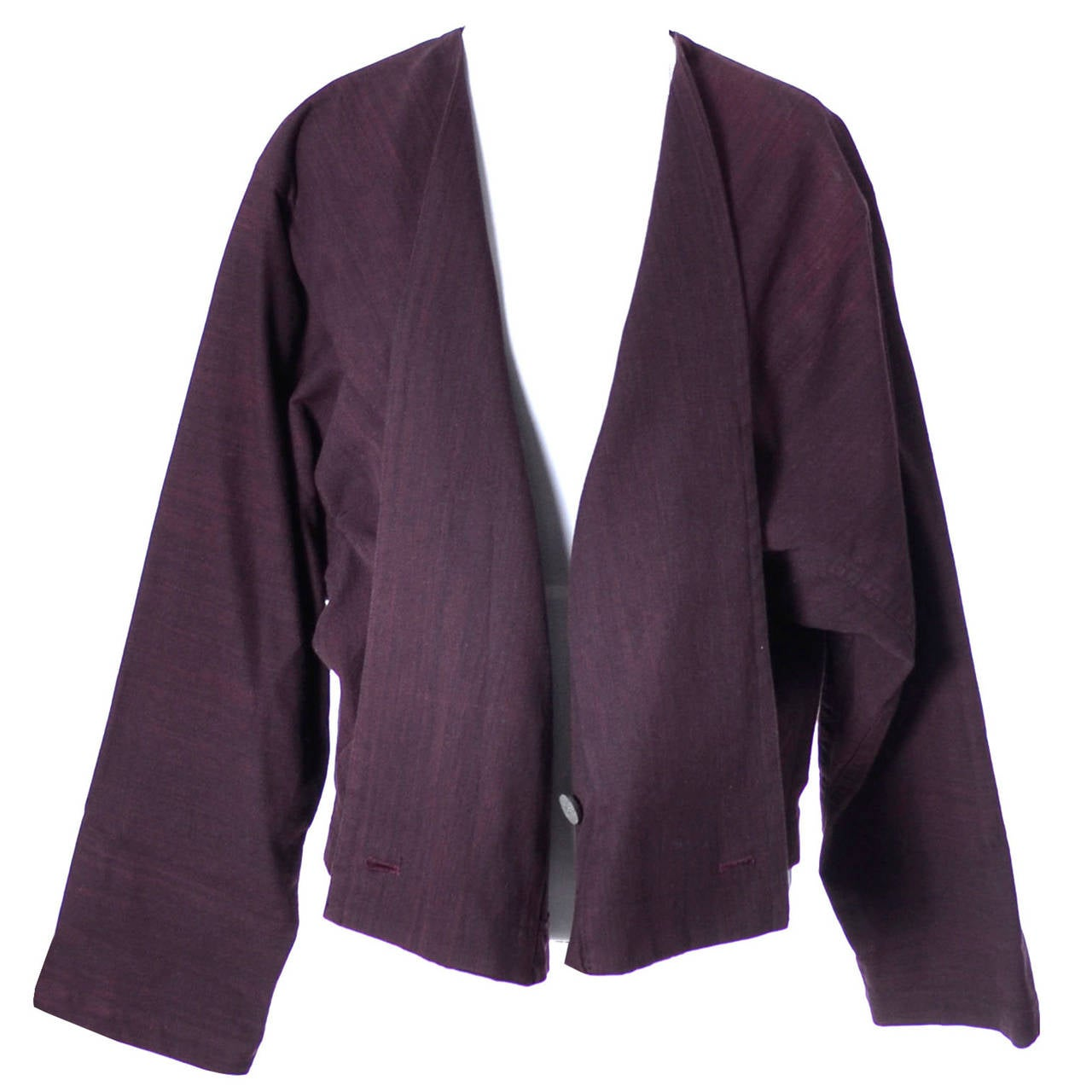 This is a vintage kimono style top / jacket from Issey Miyake Plantation in heavy plum purple cotton with iconic Miyake oversized styling.  This fabulous vintage top is labeled a Medium but could be worn as a large for a different fit. There are