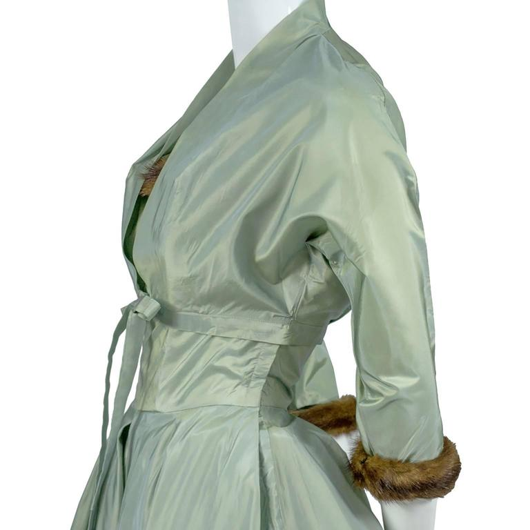 "This vintage clothing ensemble was purchased at ""Doops"" a very exclusive Hollywood clothing store, during the 1950's. This store carried clothing from only the best designers of the time and this outfit bears the ""Doops"" label. It is a gorgeous"