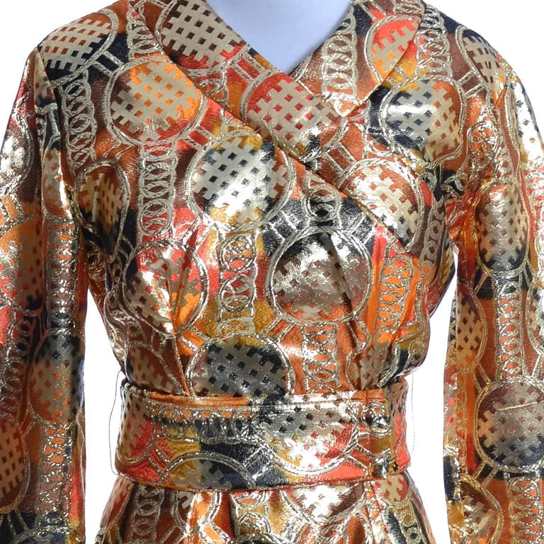 This is an amazing vintage late 1960's or early 1970's Krist of California gold lame mod kimono style maxi dress. This orange, black, brown and gold metallic sparkle formal vintage dress is in as new condition and has a back zipper, a slit up the