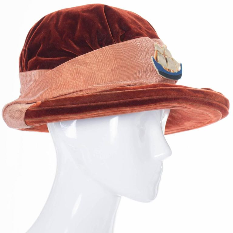 This is a fabulous antique copper velvet vintage hat from the earlier part of the 20th century. Wide brim with silk grosgrain ribbon and an amazing ship! This collectible Edwardian hat has a label that reads; By Regina