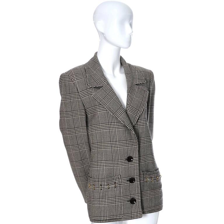 This is a vintage Valentino Boutique blazer fab metal rings on the pockets and the cuffs of the sleeves. The jacket is fully lined and made in a plaid black and ivory wool.  Please use the measurements as a guide for the best fit, but I would