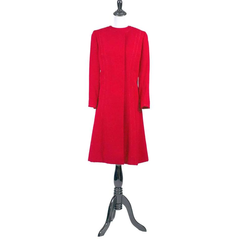 This is the perfect holiday ensemble! A vintage late 1950's ore early 1960's sleeveless red sheath dress with a matching red coat that has gorgeous green silk lining.  This dress suit was acquired when I purchased the entire estate of a prominent