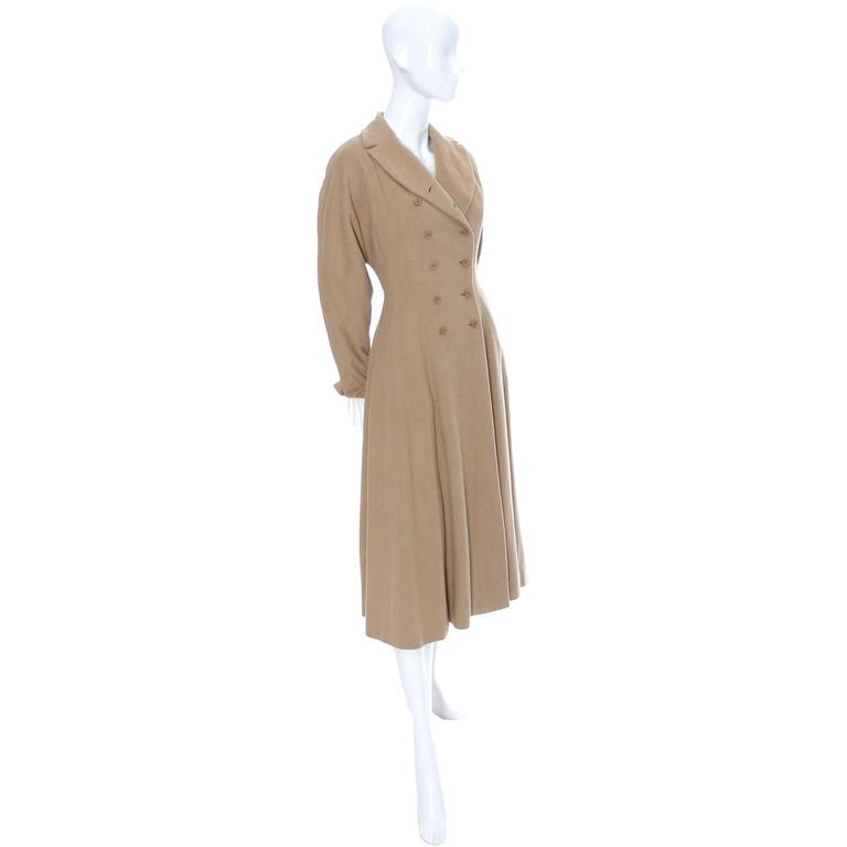 This is an exquisite, rare vintage 1940's coat from designer Vera Maxwell.  It is in excellent condition and comes from a prominent Northwest estate of high end designer mid century clothing. The coat has a full skirt, fitted waist, dolman sleeves