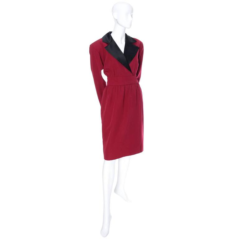 This beautiful vintage YSL dress in in a beautiful shade of red wool with a pretty black satin lapel.  This dress is in excellent condition - the only thing found is that the previous owner added a small amount of velcro underneath to keep it closed