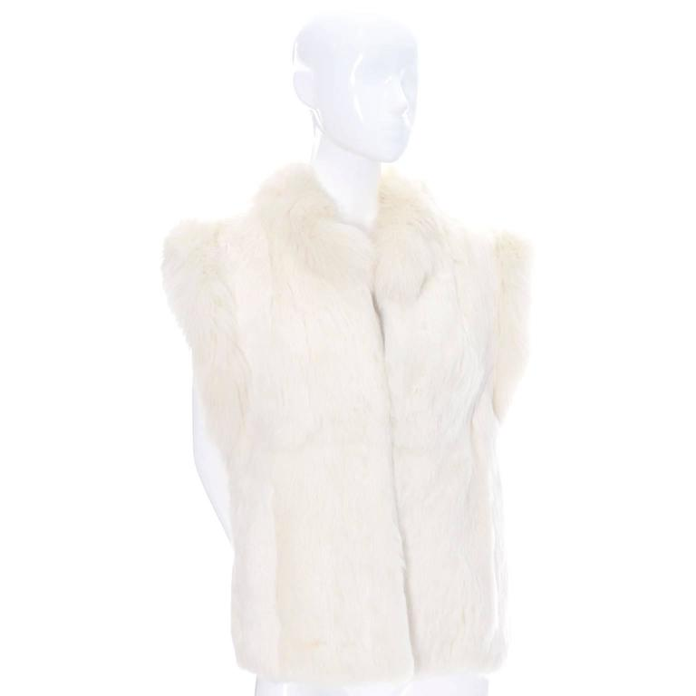 """This is a 1980's vintage ivory white rabbit fur vest with open front that fits up to a size 40"""" bust.  This vest is 24"""" long from the nape of the neck and the rabbit fur itself is from France and this pretty, incredibly soft vest is in"""