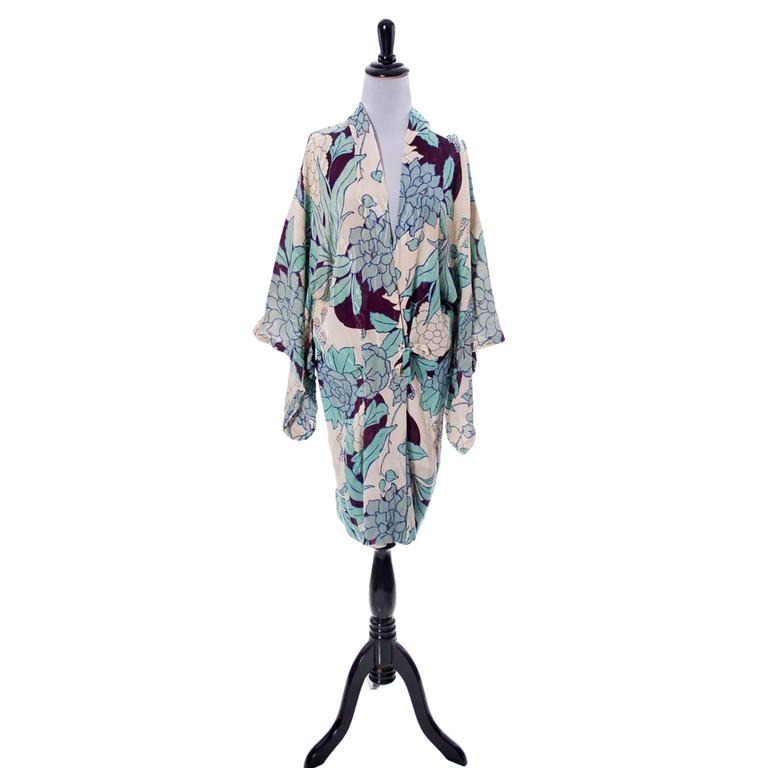 This is a really beautiful late 1920s or early 1930s Japanese fine silk vintage Kimono floral robe with self ties. The floral pattern is gorgeous in shades of blue and deep eggplant.  This measures  37