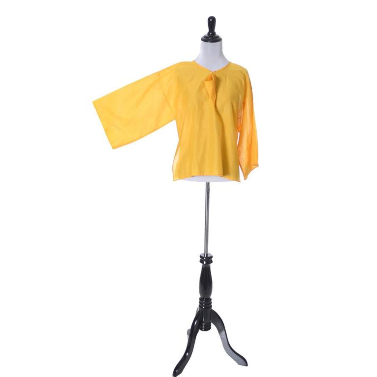 This vintage 1970's citrus yellow orange cotton boxy top has fabulous kimono style sleeves and was designed by Jean Charles de Castelbajac for Ko and Co.  This beautifully designed vintage blouse is in excellent condition and was purchased at Henri