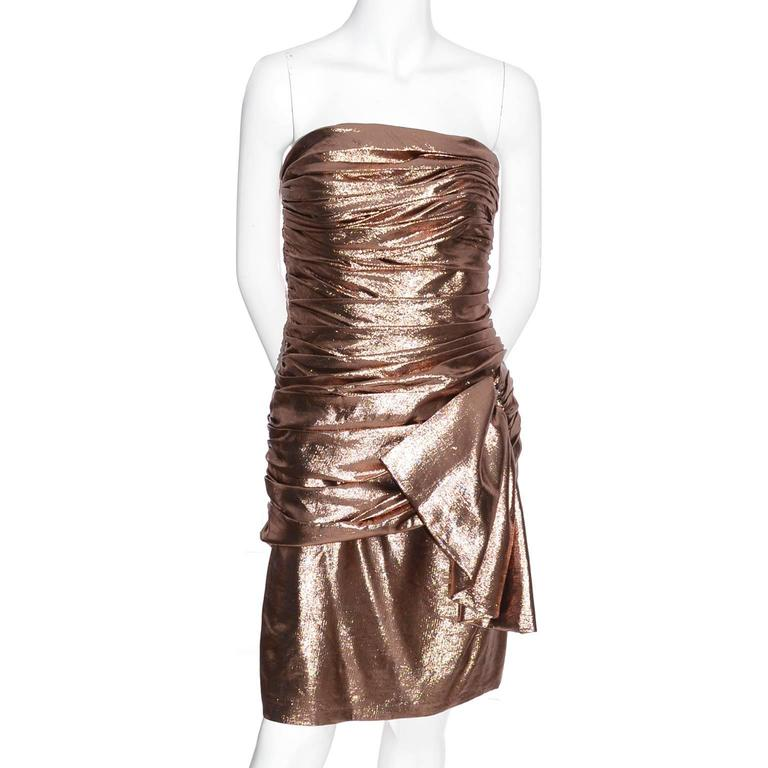 This is a bombshell vintage dress from designer Vicky Tiel from the 1980's.  The dress is strapless with a side zipper and is fully lined.  The pleating is gorgeous and there is a great side wide fabric
