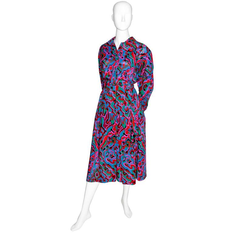 This vintage YSL 2 piece dress has a beautiful button front blouse and a skirt with a fitted waistband.  This Saint Laurent Rive Gauche vintage outfit is in a fab multi colored print and the blouse is labeled a size 44, but please use the