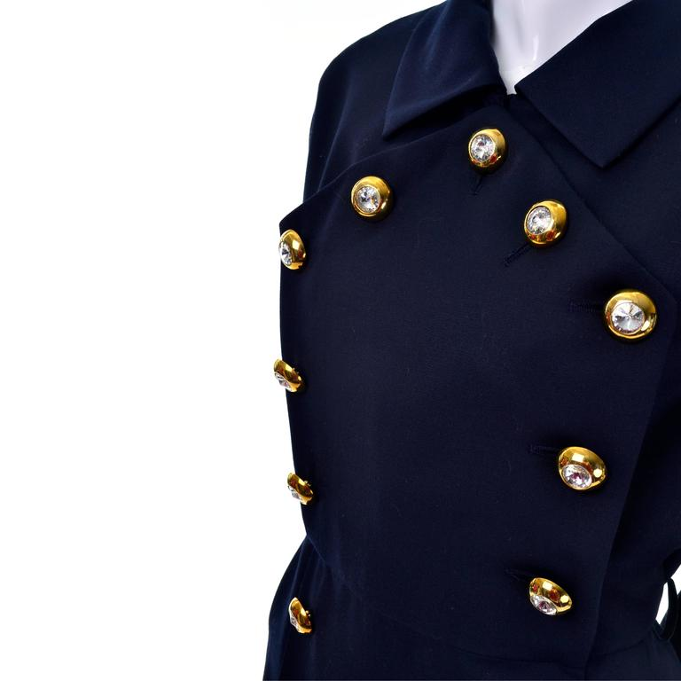 This lighter weight deep navy 100% fine wool vintage dress was purchased at Saks Fifth Avenue in the 1990's.  The dress is lined and has incredible gold tone buttons with giant crystals in the centers.  This dress comes from the estate of a YSL