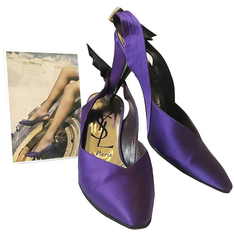 These fabulous documented vintage purple satin YSL shoes have pretty rhinestone buckles and a