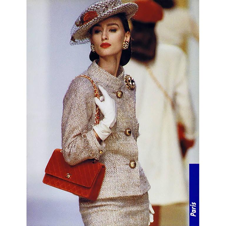 This vintage Chanel suit was designed by Karl Lagerfeld and it is from the Fall Winter 1988 collection.  We are showing the photo of it being modeled by Aly Dunne.  This suit came from an estate that had many vintage Chanel pieces.  Both the skirt
