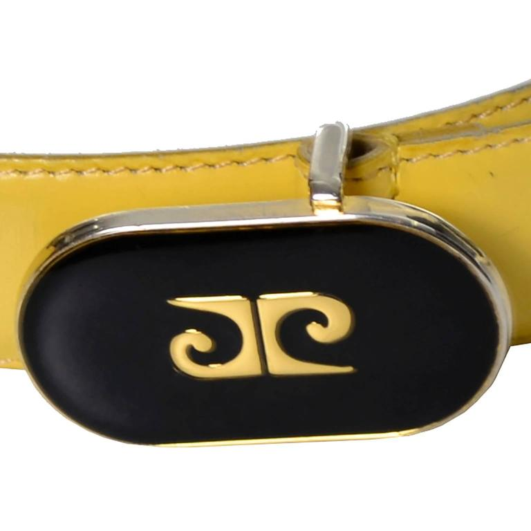 "This vintage Pierre Cardin belt is in a sunny yellow leather and fits waist sizes 28, 29, 30, 31 and 32"".  The belt is marked Pierre Cardin Paris with the number 053231 Cuir Liege Double Suede Made in France and the size 80/32.  This fabulous"