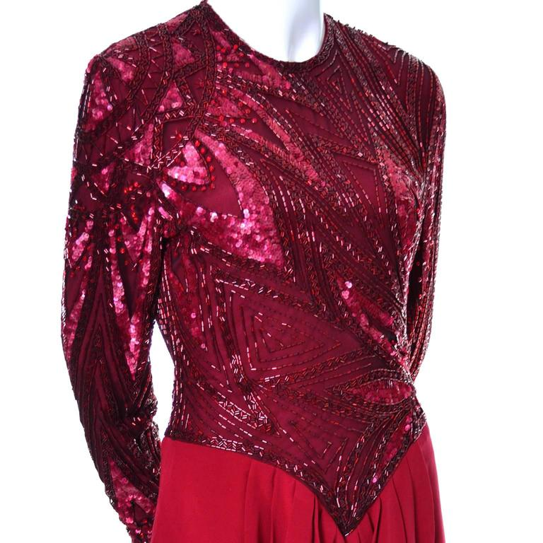 This stunning 1980's Bob Mackie vintage dress would be perfect for any special evening or cocktail party! The dress has a silk crepe skirt and the bodice is mesh over crepe that is finely beaded with bugle beads and embellished with red sequins and