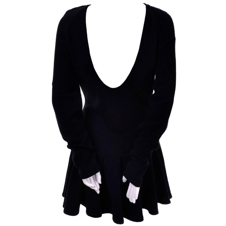 This is a great vintage dress from Kenzo that is a perfect foundation piece! The low scoop back dress is made of thick a black ribbed cotton and was made in Portugal. This ice skater style dress has a low scoop back, long sleeves, and slips overhead