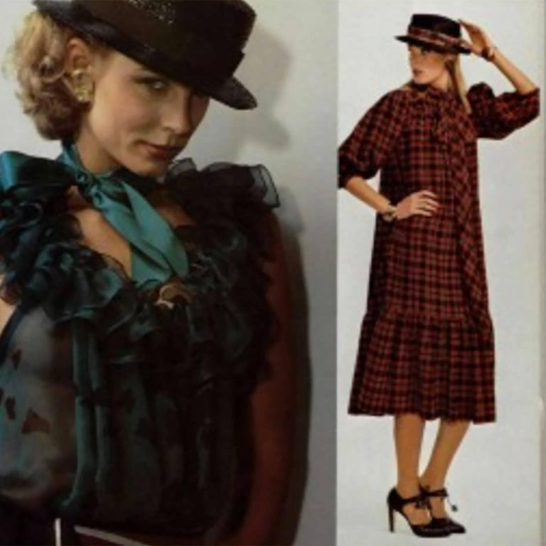 This vintage dress was designed by Yves Saint Laurent in the late 1970's. We have shown a photo from L'Officiel in 1978 with the model wearing the sash as a bow and the dress loosely. The dress is red, blue and light mustard plaid and has ruffles at