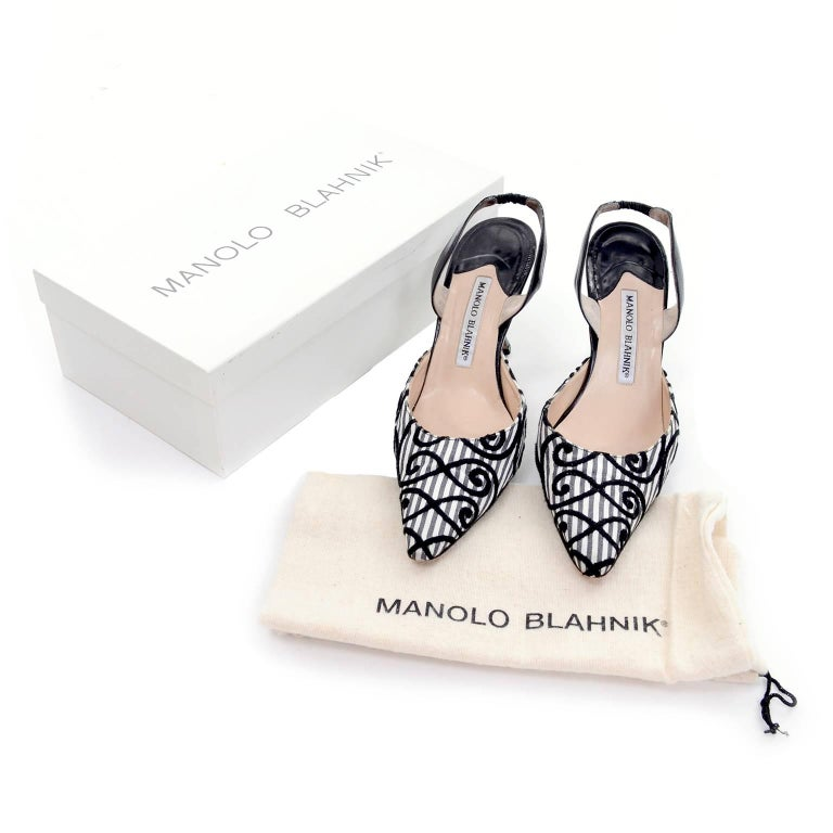 These vintage Manolo Blahnik Carolyne shoes have black velvet patterned swirls on Charcoal and white striped fabric and black leather trim. These slingback shoes are labeled a size 37.5 and have 3 and 7/8