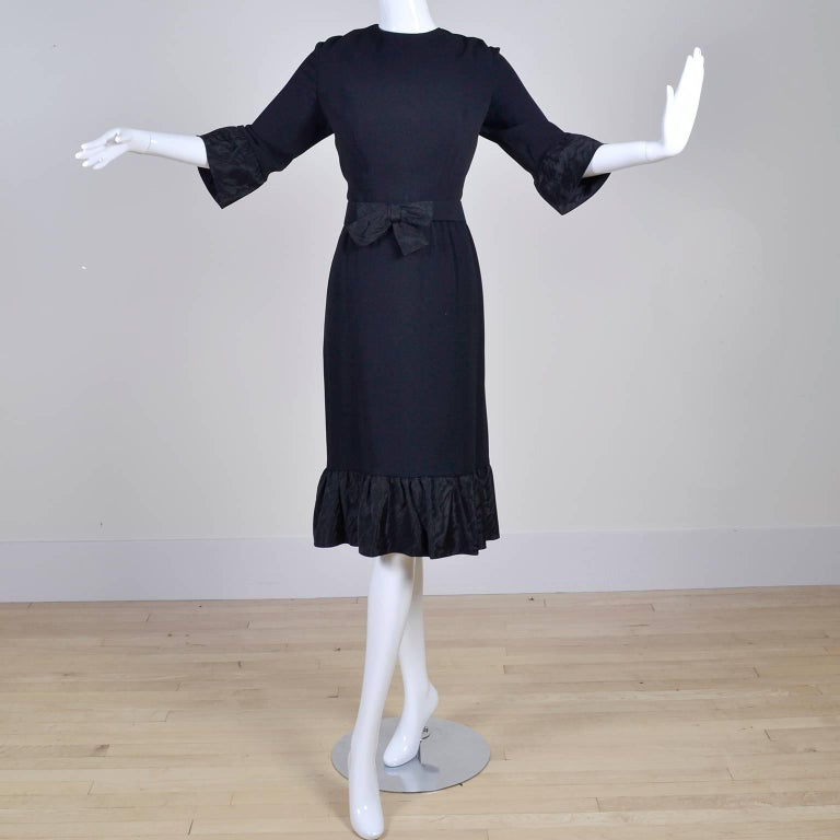 This vintage dress was designed by Jo Copeland in the late 1960's. The dress is a fine wool crepe with fabulous taffeta ruffles at the cuffs and hemline.  This wonderful Pattullo-Jo Copeland dress has 3/4 length sleeves, is fully lined and comes