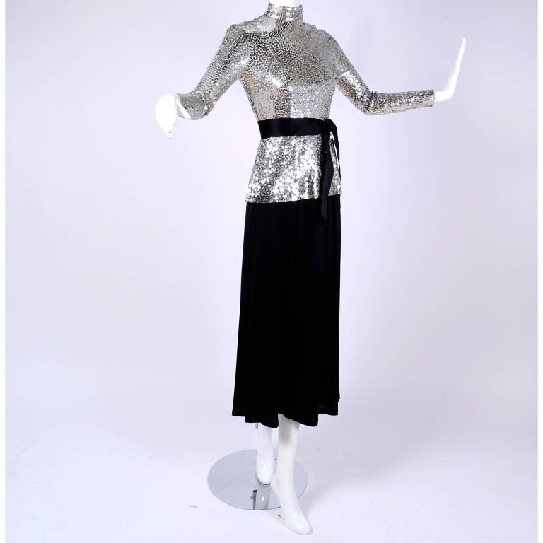This vintage 2 piece dress was designed by Norman Norell. The long sleeved top is covered in brilliant silver sequins and it is paired with a simple black skirt. Please press